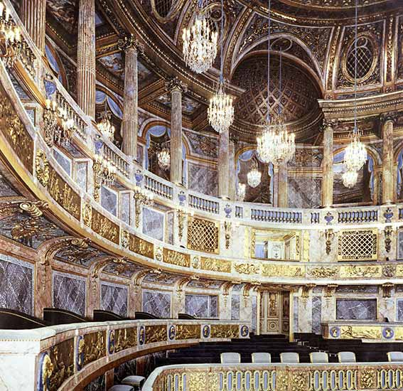 The Chateau de Versailles theater, lighted by Delisle chandeliers from the memory of craftmen and the inventory description from before the French Revolution.